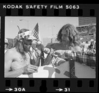 Three men lighting peace pipe filled with marijuana during demonstration for legalizing marijuana in Los Angeles, Calif., 1981