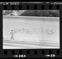"Graffiti stating ""No Boring Murals"" covering sketch for mural on underpass in Santa Monica, Calif., 1981"