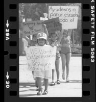 "Four girls carrying signs, one reading ""We Want Better Education NO Year Round School"" in Los Angeles, Calif., 1981"