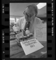 "Health food store owner, Robert Boyd, displaying ""fruit fly survival kit"" in Los Altos, Calif., 1981"
