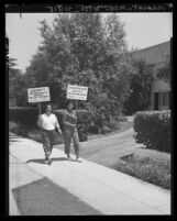 Carmen Lugano and Rosemary Rodriquez picket home of owner of a Glendale plastics company, 1951