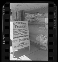 Sidewalk sign and entrance of Jewish Family Service's Valley Storefront in Los Angeles, Calif., 1981