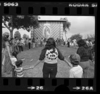 Victory Outreach members holding outdoor prayer service in East Los Angeles, 1981