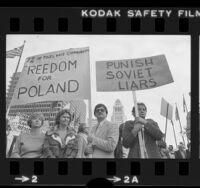 "Polish Americans carrying signs, one reading ""Punish Soviet Liars"" during protest in Los Angeles, Calif., 1981"