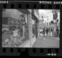 Chinatown storefronts with signs in Chinese and Vietnamese, Los Angeles, Calif., 1982