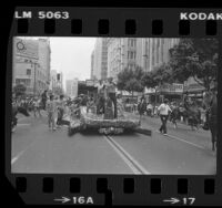 Magic Johnson and Pat Riley riding on float during parade celebrating the Los Angeles Lakers' 1982 Championship