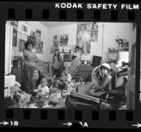 Sabina de la Cruz with her children in a Skid Row hotel in Los Angeles, Calif., 1983