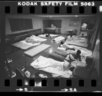 Youths sleeping on mattresses on the floor at Central Juvenile Hall in Los Angeles, Calif., 1983