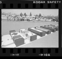 People gathered near flag-draped coffins protesting the downing of Korean Air Lines Flight 007, 1983