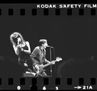 X's Exene Cervenka and John Doe performing at the Greek Theater, Calif., 1983