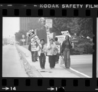 Striking McDonnell Douglas workers picketing plant in Long Beach, Calif., 1983