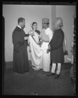 Los Angeles judge Stanley Mosk knotts couple's gowns in Hindu fashion following marriage in 1947