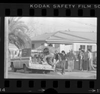 Illegal workers jumping onto truck in Santa Ana, Calif., 1984
