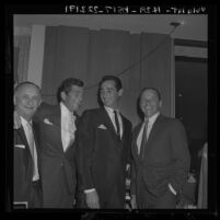 Sandy Koufax flanked by Frank Sinatra and Dean Martin at event naming Koufax pitcher of the year, 1963