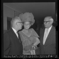 Morris Lavine with attorneys George A. Forde, Gladys Towles Root during arraignment on unethical conduct in Los Angeles, Calif., 1964