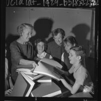 Frances Blend School for the Blind's Jean Kentle and Rosalie Calone passing out Braille books to students, Calif., 1963