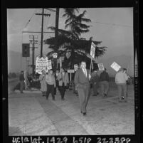 Pickets from Local Union 399 walking picketline at gate of Santa Anita Park, Calif., 1964