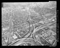 Aerial view of construction of Santa Monica Freeway at San Diego Freeway interchange in Los Angeles, 1963