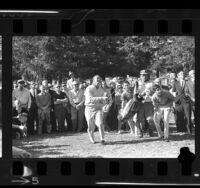 Arnold Palmer and crowd watching flight of his golf ball at the Los Angeles Open, 1964