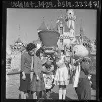 Korean student, Jong Sook Kim, visiting the Mad Hatter and Alice at Disneyland, Anaheim, 1964