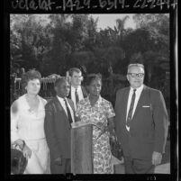 Uganda politician Basil K. Bataringaya and wife, Edith Mary with Mr. and Mrs. Frank Klock at Disneyland, 1964