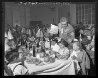 Joe Morse with orphans at Thanksgiving dinner Friar's Club Los Angeles, Calif., 1948