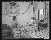 UCLA seniors, Louise Haggard and Gloria Jones in their dorm room in Hershey Hall, 1948