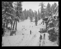 Children playing on snow covered Kratka Ridge in the Angeles National Forest, Calif., 1963