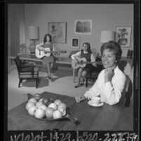 Building contractor Sarah Jane Lapin sitting with her daughters at home she built in Los Angeles, Calif., 1964