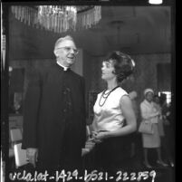 Actress Gigi Perreau chatting with Cardinal James Francis McIntyre at entertainment industry communion breakfast, Calif., 1964