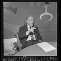 Advertising executive, William Bernbach at press conference discussing his stance against cigarette advertising, Calif., 1964