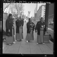 Four Japanese Sumo wrestlers in traditional garb on sightseeing walk in downtown Los Angeles, 1964