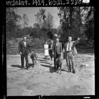Mayor Samuel W. Yorty with five people inspecting site of the future Children's Zoo in Griffith Park, Calif., 1964