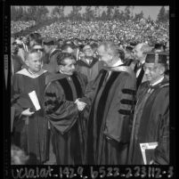 Mexico's President Lopez Mateos shaking hands with Lyndon Johnson at UCLA commencement, 1964