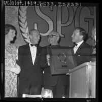 Arthur Freed with Gene Kelly, Fred Astaire and Julie Andrews as he receives the Screen Producers Guild's Milestone Award, 1964