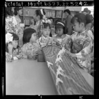 Japanese American girls with a koto during Japanese Girls Day at Robert Hill School in Monterey Park, Calif., 1964