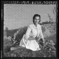 Los Angeles County Deputy Sheriff and homemaker Patricia Wood seated in her garden, 1964