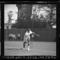 UCLA tennis player Arthur Ashe firing a backhand volley at Dennis Ralston in Southern California Intercollegiates, 1964
