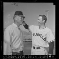 Pitcher Aubrey Gatewood and football player Don Hutson at Angels' training camp in Palm Springs, Calif., 1964