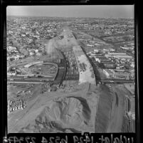 Aerial view of excavation and beginning construction of Santa Monica Freeway at La Cienega and Venice Blvds, 1964