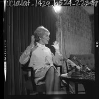 Actress Janet Leigh in animated gestures during press conference in Los Angeles, Calif., 1964