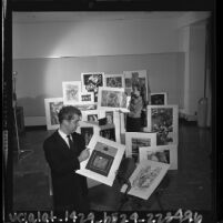 Walter Askin and Betty LaDuke surrounded by prints at the 10th anniversary Westside Jewish Community Center's art exhibit, Calif., 1964