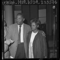 """Charles Evers and Birmingham church bombing survivor Ethel Madison upon arrival for """"Freedom Parade"""" in Los Angeles, Calif., 1964"""