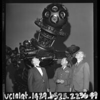 William Frederickson, Charles Yeager and Dr. C. H. Cleminshaw standing before Griffith Park Observatory's new planetarium projector, Los Angeles, 1964