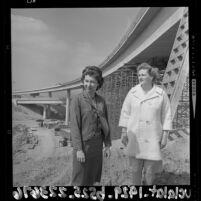 Civil engineers Marilyn Reece and Carol Schumaker standing next to the Reece designed Santa Monica - San Diego interchange, 1964