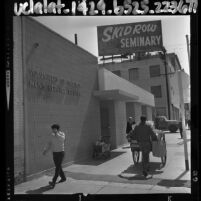Men walking by entrance to Los Angeles' Skid Row Volunteers of America Men's Service Center, 1964