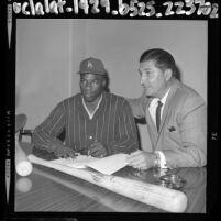 17 years old Willie Crawford, signing his baseball contract with Los Angeles Dodger scout Al Campanis, 1964