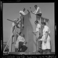 Two instructors teaching four Peace Corps trainees carpentry at California State College, Los Angeles, 1964