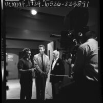 """Richard Chamberlain with directors Leo Penn and Wilbur Mosier on the set of television program """"Dr. Kildare"""", 1964"""