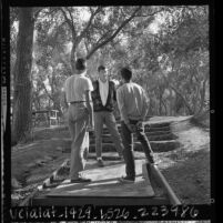 Juvenile offenders counselor talking with pair of boys at youth rehabilitation Camp Malibu, Calif., 1964